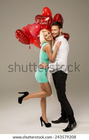Happy loving couple on grey background  - stock photo