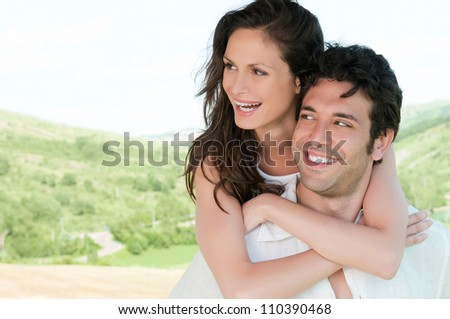 Happy loving couple smiling and enjoy the nature outdoor - stock photo