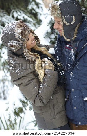 Happy loving couple smiling, embracing at wintertime. - stock photo