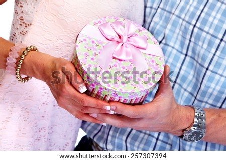Happy Loving couple with gift isolated over white background. - stock photo