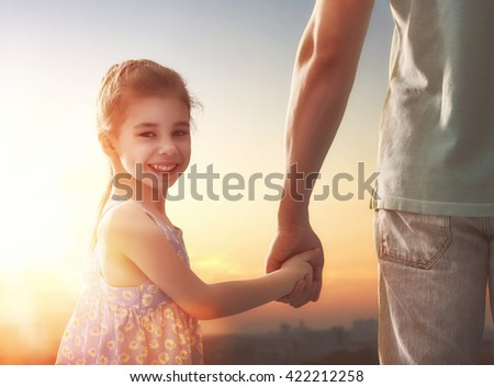 Happy loving family. Father and his daughter child girl playing outdoors. Cute little girl and daddy. Concept of Father's day. - stock photo
