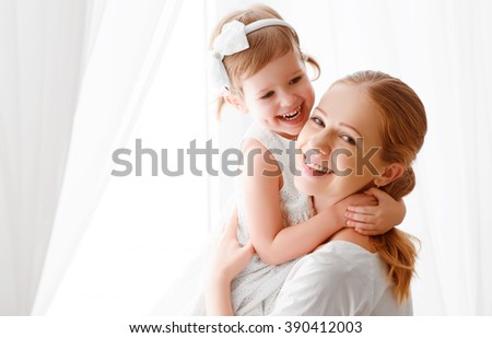 Happy loving family. mother and child girl hugging and hugging