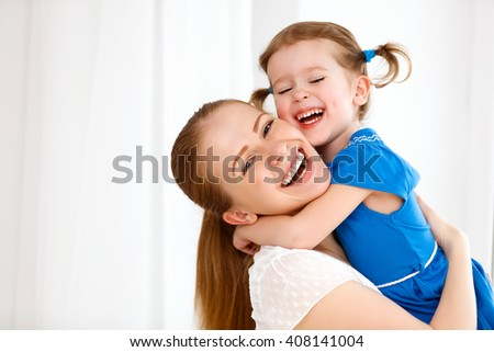 Happy loving family. mother and child girl laughing and hugging - stock photo