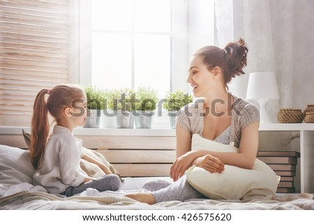 Happy loving family. Mother and her child girl playing together.  - stock photo