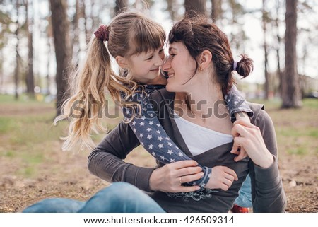 Happy loving family. Mother and her daughter child girl playing  - stock photo