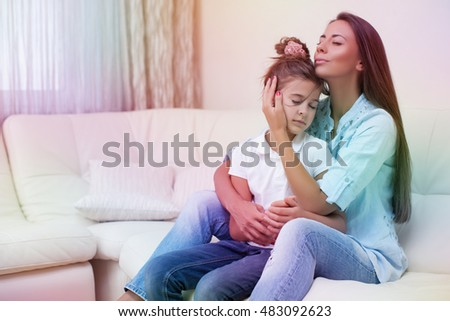 Happy loving family. Mother and her daughter child girl playing.