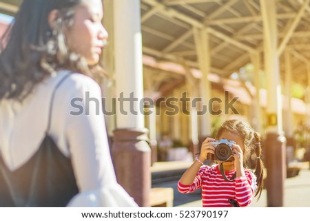 Happy loving family. Mother and her daughters children girls playing and making photo.