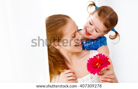 Happy loving family. mothers Day. daughter gives her mom flowers