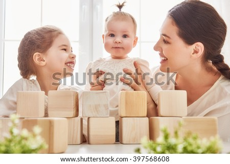 Happy loving family playing with blocks and having fun.  - stock photo