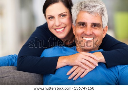 happy loving middle aged couple relaxing at home - stock photo