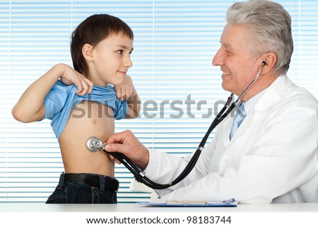 Happy luck Caucasian doctor with patients on a light background