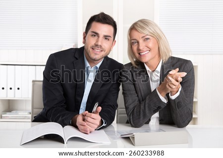 Happy male and female business team sitting in the office. Successful collaboration or partnership, - stock photo