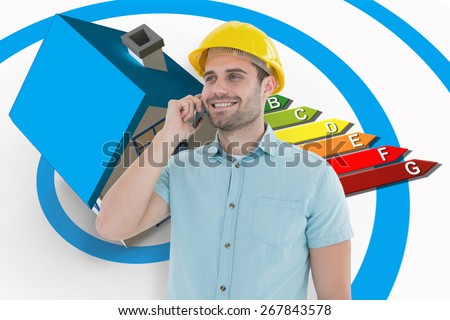 Happy male architect conversing on mobile phone against energy ratings chart coming from 3d house - stock photo