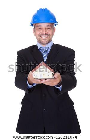 Happy Male Architect Holding Model House On White Background - stock photo