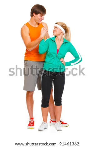Happy male athlete and fitness young woman handshaking isolated on white