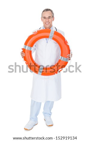 Happy Male Doctor Holding Rescue Ring on white background - stock photo