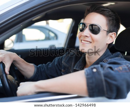 Happy male driver - stock photo