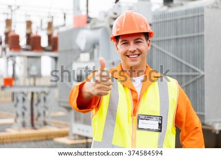 happy male electrician with thumb up at electric substation