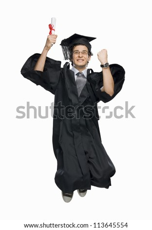 Happy male graduate holding his diploma and jumping - stock photo