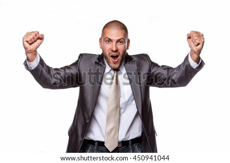 Happy male in a grey suit isolated on a white background.