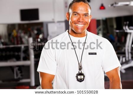 happy male personal trainer half length portrait - stock photo