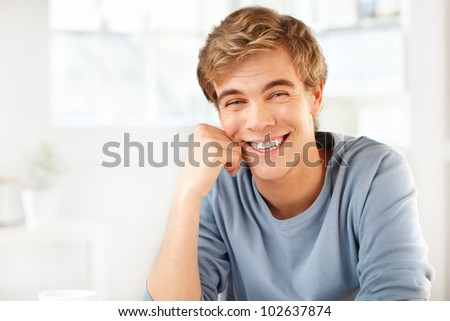 happy male student smiling indoors