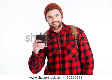 Happy male traveler holding alcohol flask isolated on a white background