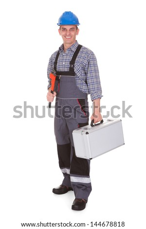 Happy Male Worker Holding Worktool Over White Background - stock photo
