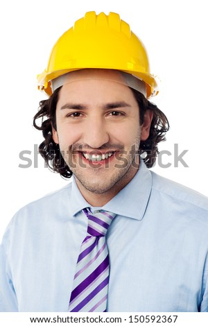 Happy male worker wearing safety helmet