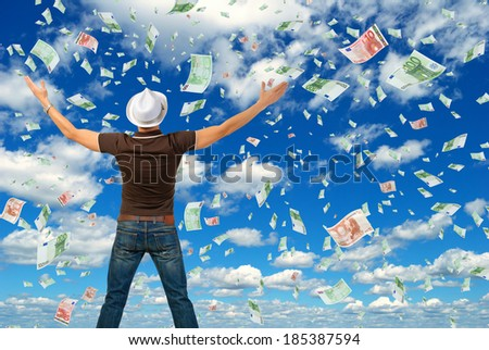Happy man and a lot of money. - stock photo