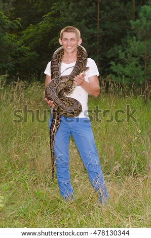 Happy man and snake