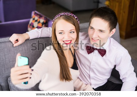 happy man and woman take selfie in the cafe