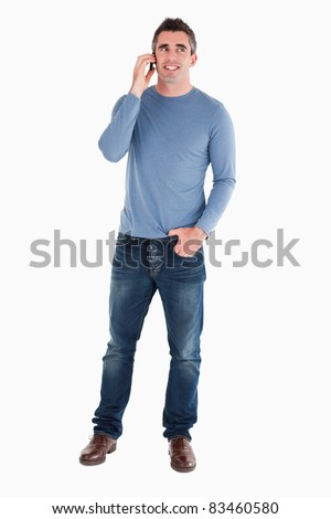 Happy man answering the phone against a white background - stock photo