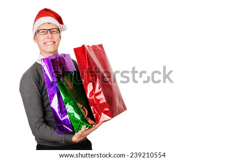 happy man buying xmas gifts and presents concept isolated on studio background - stock photo