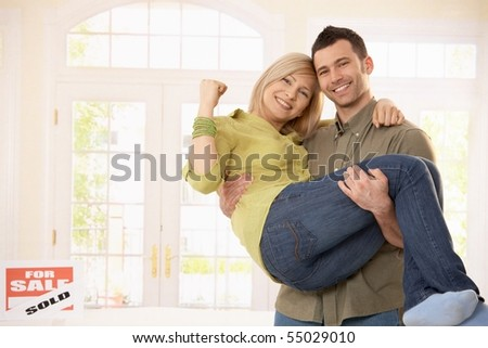Man carrying woman in arms stock photos illustrations and vector art