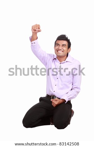 happy man celebrating his success isolated over a white background - stock photo