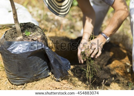 Happy Man digs a hole to planting