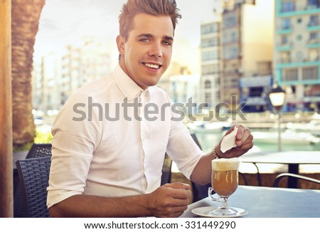Happy man drinking a coffee
