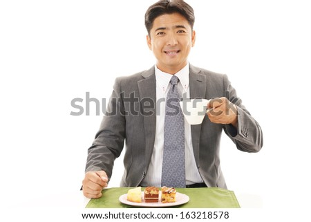 Happy man eating desserts - stock photo