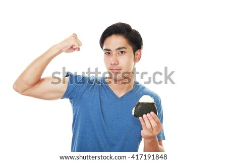 Happy man eating meal - stock photo