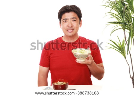 Happy man eating meals