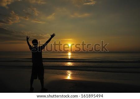 Happy  man enjoy first moment of sunrise - stock photo