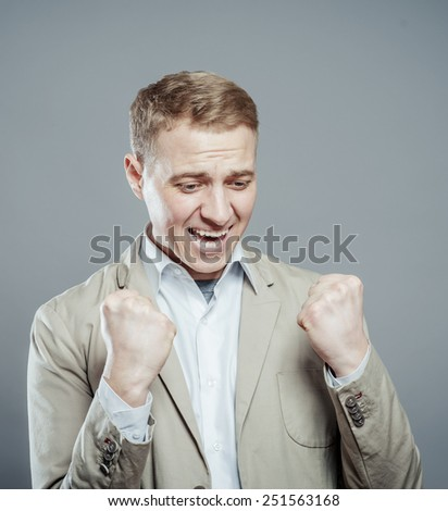 happy man exults - stock photo