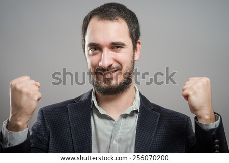 happy man exults - stock photo