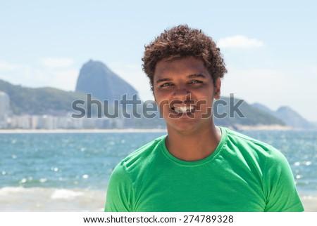 Happy man from Rio de Janeiro at Copacabana beach - stock photo