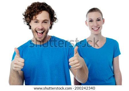 Happy man gesturing thumbs up to camera - stock photo