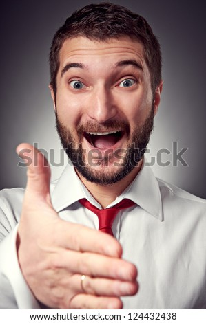 happy man giving hand for handshake over grey background