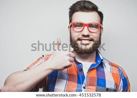 happy man giving thumbs up sign - stock photo