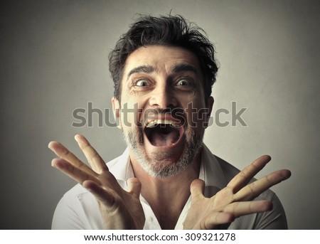 Happy man going crazy - stock photo