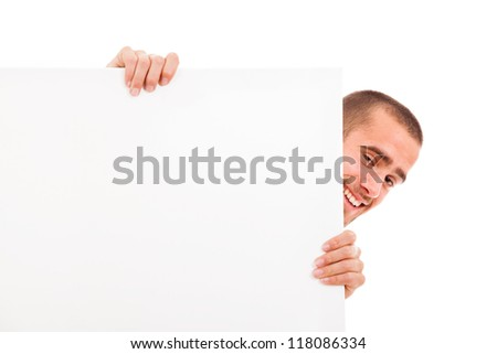 Happy man holding a blank white board - stock photo